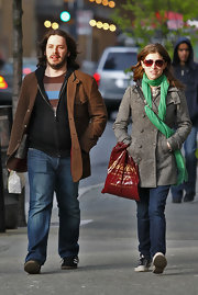 Anna Kendrick perked up her ensemble with a bright green scarf while out shopping.