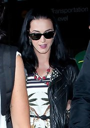 Katy Perry accessorized her airport look with a layered beaded necklace.