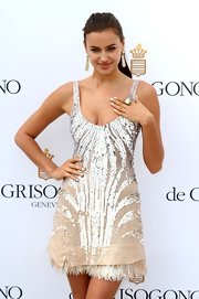 Irina matched her nails to her shimmering sequined dress.