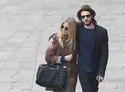 Sienna Miller showed off a Miu Miu Nappa Cloquet Frame bag while out on a stroll with her boyfriend.