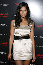 Padma Lakshmi cinched in her gold mini dress with a wide black belt for the 'Filth and Wisdom' screening.