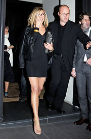 Jennifer Aniston styled her dress with strappy nude heels by Pierre Hardy.