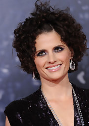 Stana Katic went for a smoldering beauty look with a heavy dose of smoky purple eyeshadow.
