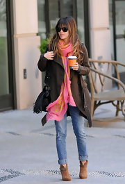 Rachel Bilson's ensemble looked much cheerier with the addition of a bright pink and yellow scarf.