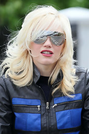 Gwen Stefani was spotted at a park sporting wind-blown feathered waves with side-swept bangs.