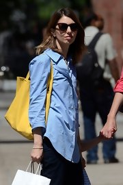 Sofia Coppola's yellow Celine Cabas contrasted nicely with her blue button-down.