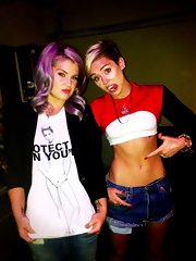 Miley Cyrus' killer abs were on full display in a two-tone shrug sweater layered over a white crop-top in this social media pic.