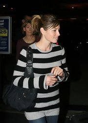 Jessica Biel caught a flight at LAX carrying a casual blue nylon bag.