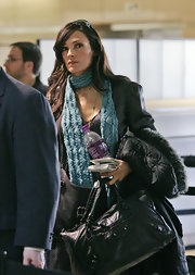 Famke Janssen was seen at LAX carrying a large leather tote.