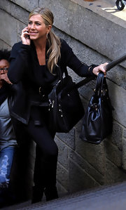 Jennifer Aniston was spotted on the set of 'Wanderlust' carrying a black leather shoulder bag and a matching tote.