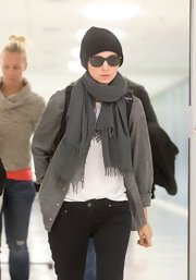 Rooney Mara completed her cozy ensemble with a gray scarf by Chan Luu.