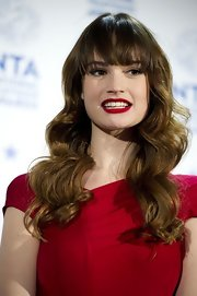 Lily James sported fabulously sculpted waves and eye-grazing bangs during the National Television Awards.