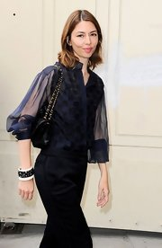 Sofia Coppola accessorized with a star-embellished cuff bracelet by Chanel when she attended the label's fashion show.