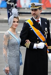 Princess Letizia paired a feathered blue fascinator with a lace gown for King Willem-Alexander's investiture.