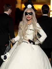Lady Gaga got heavily blinged up with a Chanel cuff and layers of pearls.