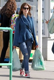 Anna Kendrick cozied up in a chic blue shawl-collar cardigan while out shopping.