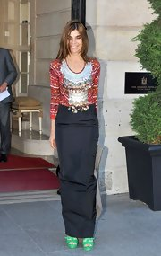Carine Roitfeld teamed a fancy coin-embellished print top with a long black skirt for the Versace Couture fashion show.