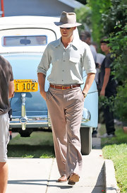 Ryan Gosling paced around the set of 'Gangster Squad' in a pair of loose brown slacks.