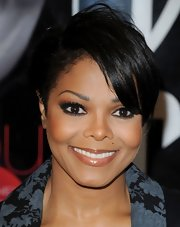 Janet Jackson attended her book launch wearing a short side-parted hairstyle.