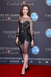 Lily Collins wore a sexy lace dress by Michail Sykianakis for the Mexican premiere of 'The Mortal Instruments: City of Bones'.