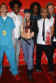A red and black striped tie added a quirky touch to Gwen Stefani's ensemble.