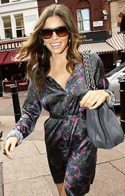Jessica Biel complemented her dress with a gray Fendi Mia Borsa chain-strap bag.