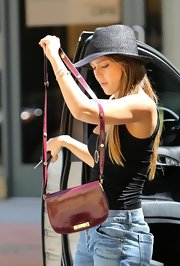 Jessica Alba topped off her warm-weather look with a black straw hat.