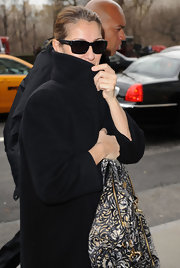 Celine Dion looked a little shy with her wayfarers and upturned collar while out and about.