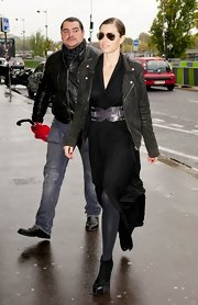 Jessica Biel visited the Musee d'Orsay looking tough-chic in a black leather moto jacket layered over a wrap dress.