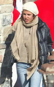 Charlotte Casiraghi wore a beige pashmina for added warmth.