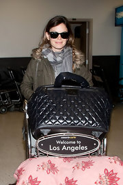 Rachel Bilson had her hands full with a huge Chanel duffle bag and a pink pillow as she landed at LAX.