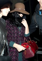 Katy Perry was spotted at LAX wearing a brown wide-brimmed hat.
