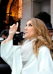 Celine Dion styled her outfit with a light gray scarf for a day out in Paris.