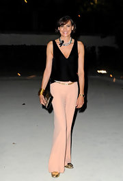 Ines de la Fressange stepped out at PFW wearing a black silk tank and a pair of pastel pants.