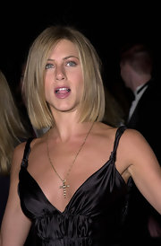 Jennifer Aniston paired a cross pendant with a plunging gown for her 2001 People's Choice Awards look.