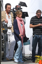 Jennifer Aniston filmed scenes on Rodeo Drive rocking a pair of blue flare jeans by Paige.