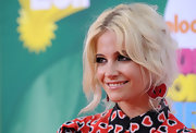 Pixie Lott's dangling apple earrings and heart-print dress, both by Miu Miu, were a super-fun pairing.