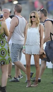 Kate Bosworth looked youthful and cute in a laser-cut white tank top by Topshop during Coachella.