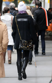 Jessica Biel carried an edgy-chic studded shoulder bag with a gold chain strap as she took a stroll in the West Village.