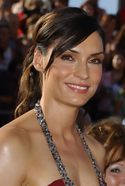 Famke Janssen had her tresses curled and tied up in a ponytail for the Emmys.