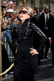 Lady Gaga promoted her perfume in Paris wearing an all-black nail polish, dress, and jacket combo.