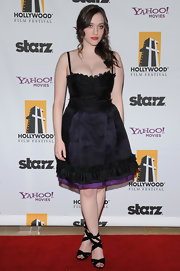 Kat Dennings complemented her ultra-girly dress with a pair of black strappy sandals.
