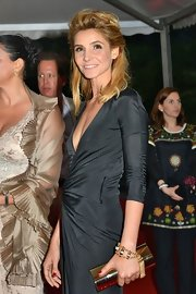 Clotilde Courau accessorized with a chic gold tube clutch at the IWC and Finch's Quarterly Review Filmmakers Dinner.