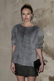 Kate Bosworth attended the Topshop fashion show carrying a trendy black foldover clutch from the label.