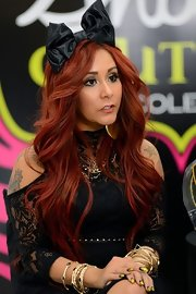 Nicole Polizzi finished off her outfit with tons of gold bangles on both wrists.