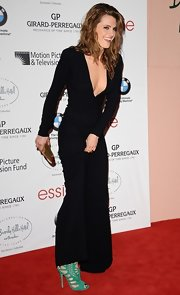 Stana Katic injected a bright pop via green cage sandals by Jimmy Choo.