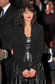 Marion Cotillard arrived for the 'Les Petits Mouchoirs' premiere wearing a boxy black blazer over a metallic dress.