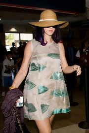 Katy Perry looked summery wearing this straw hat by Eugenia Kim while catching a flight.