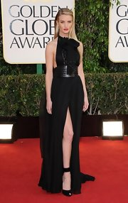 Rosie Huntington-Whiteley styled her gown with an oversized black Yves Saint Laurent belt.