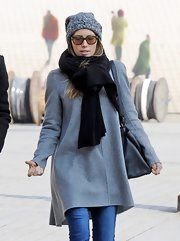 Jessica Biel looked all set for cold weather in Paris with this black scarf and gray coat combo.